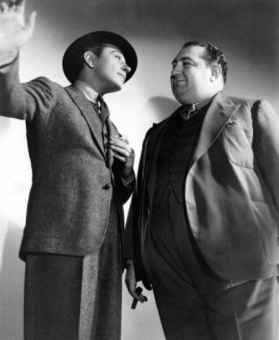 Chubby Mack Gordon asks George Raft for a pardon.