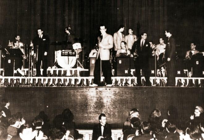 Tommy Dorsey, Gene Krupa, Dick Stabile and Charlie Barnet join Glenn on the Paramount stage.