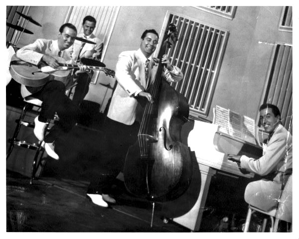 The movie's rhythm section: Bobby Hackett, Moe Purtill, Jackie Gleason & Cesar Romero.