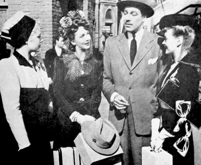 Orchestra wives Virginia Gilmore, Carole Landis and Mary Beth Hughes with Cesar Romero.