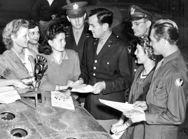 Captain Miller with star-struck fans, 1943.